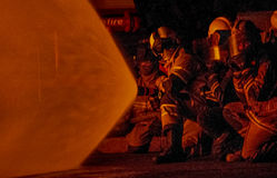 Firefighters attacking a fire Stock Image