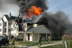 Firefighters battle an apartment fire Royalty Free Stock Image