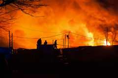 Firefighters battle a blaze Stock Photo