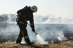 Firefighters battle a wildfire. In spring Royalty Free Stock Photo