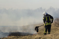 Firefighters battle a wildfire. In spring Stock Photo