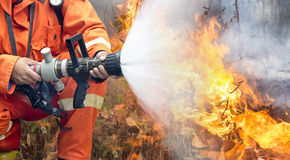 Firefighters battle a wildfire royalty free stock photo
