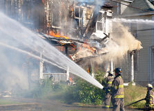 Firefighters Battling a Fire Stock Photography