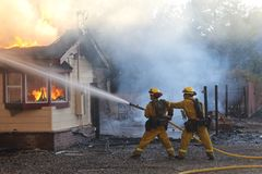 Firefighters battling a structure fire royalty free stock photography