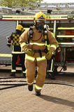 Firefighters in breathing apparatus on the move Stock Images