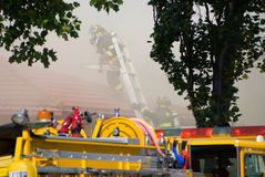 Firefighters on Buring Roof Royalty Free Stock Image