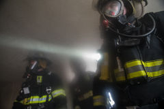 Firefighters In burning farm house Royalty Free Stock Image