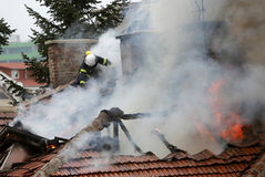 Firefighters burning house Royalty Free Stock Images