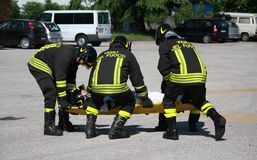 Firefighters carry a stretcher with serious injuries after the a Royalty Free Stock Photo