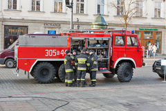 Firefighters in the center of Krakow, Poland. Fire engine and firefighters team are serving on Main Market square in Old Town. Krakow is the second largest and stock image