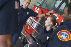 Firefighters chatting by a fire engine.  royalty free stock photo