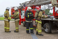 The firefighters check their equipment. Royalty Free Stock Photos