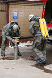 Firefighters in chemical protection suit Stock Photos