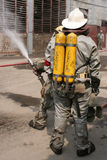Firefighters in chemical protection suit Royalty Free Stock Image