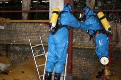 Firefighters in chemical protection suit Stock Photography
