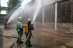 Firefighters in chemical protection suits and gas masks Royalty Free Stock Photography