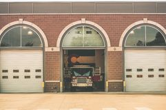Firefighters of Colorado. Fire Truck inside Firehouse. Large Colorado Flag on the Wall. Colorado Fire Department Royalty Free Stock Photography