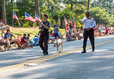 Firefighters and Dalmation in Parade. DUNWOODY, GEORGIA - July 4, 2016: Participants and spectators in the annual Dunwoody, Georgia 4th of July parade which royalty free stock photography