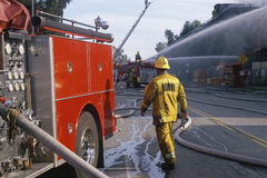 Firefighters and engines Royalty Free Stock Photos