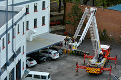 Firefighters exercise on a fire engine ladder Stock Image