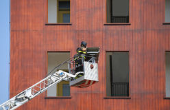 Firefighters during exercise in the firehouse and the building Royalty Free Stock Photos