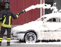 Firefighters during exercise to extinguish a fire Royalty Free Stock Photos