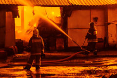 Firefighters extinguish a fire Stock Image
