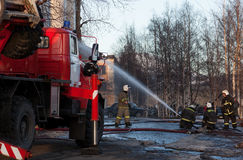 Firefighters extinguish a fire Stock Photos