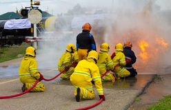 Firefighters extinguish oil train. Royalty Free Stock Images