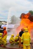 Firefighters extinguish oil train. Stock Photos