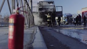 Firefighters extinguish a truck on roadway stock video footage