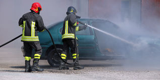 Firefighters extinguished the fire at a car Stock Image