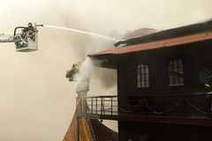 A firefighters extinguishes a burning restaurant stock photography