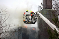 Firefighters Extinguishing Fire on Hydraulic Crane Platform Stock Photos