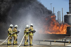 Firefighters Extinguishing House Fire. Stock Image