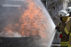 Firefighters Extinguishing House Fire. Royalty Free Stock Photography
