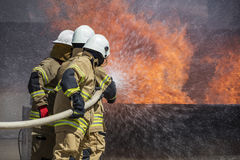 Firefighters Extinguishing House Fire. Stock Photography