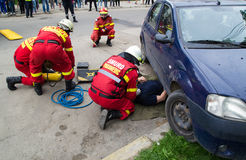 Firefighters extricating victim Stock Photo