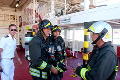 Firefighters on ferry Royalty Free Stock Photos