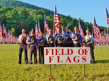 Firefighters in Field of Flags Royalty Free Stock Image