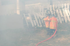 Firefighters fight a fire Stock Images
