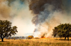 Firefighters fighting fire. royalty free stock images