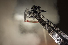Firefighters fighting fire Royalty Free Stock Photography