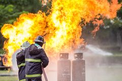 Firefighters are fighting fire. royalty free stock photography