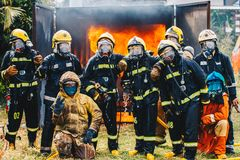 Portrait of firefighters team in uniform. Firefighters fighting fire, Firefighters training Stock Images