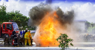 Firefighters fighting Royalty Free Stock Images