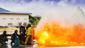 Firefighters fighting Royalty Free Stock Image