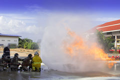 Firefighters fighting Stock Photo