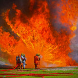 Firefighters fighting fire Stock Image