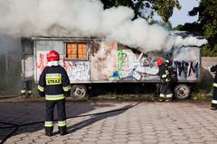 Firefighters fighting a fire of a waste place Stock Photography